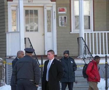 Police investigating the fatal shooting of a Mattapan boy outside the Morton Street home where he was shot.